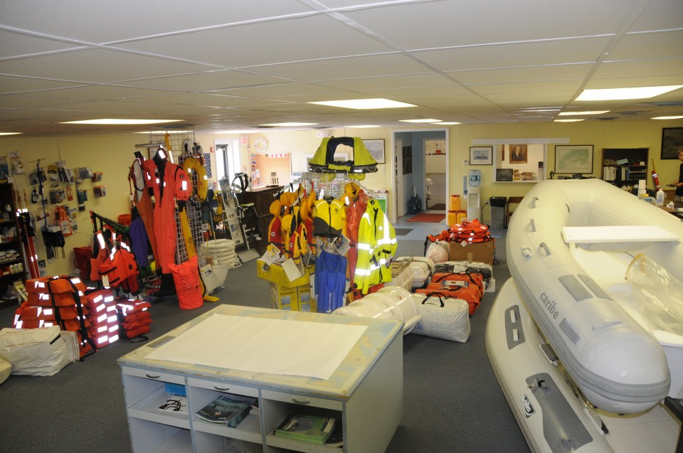 retail space with boats and marine safety gear